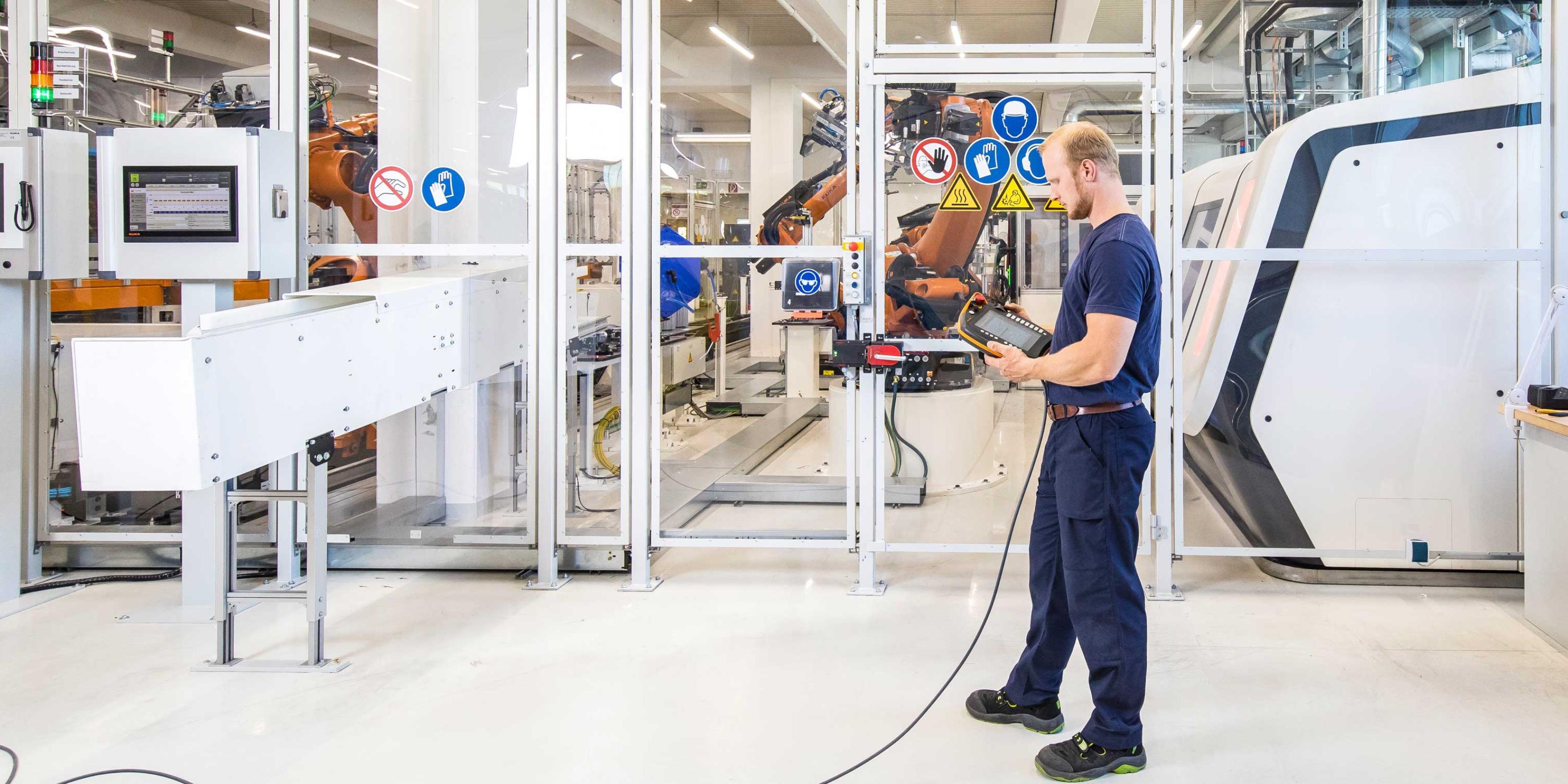 Truma employee operates Kuka robot