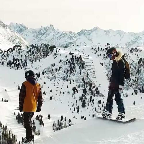 Couple with Snowboards in the mountains
