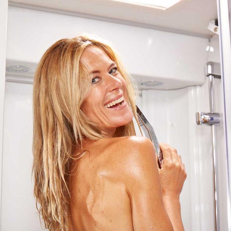 Woman taking a shower in a caravan